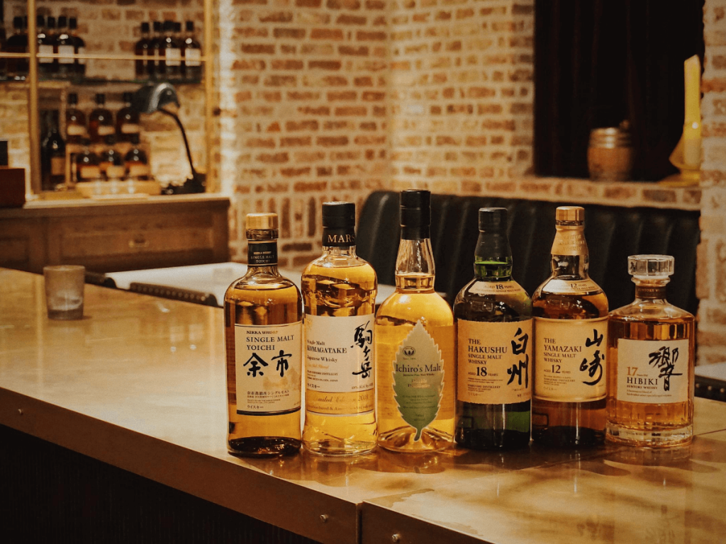japanese whisky lined up on a bar